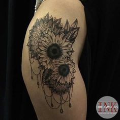 Share Tweet Pin Mail This hibiscus hip tattoo. Or maybe not? It's hard to tell by the photo. (Photo: Matt Wear) These blackwork sunflowers. Ok ...