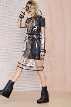 Go out and play in the rain and Have some fun with this clear out trench coat
