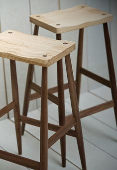 The Imo bar stool has a fixed base and a gently shaped seat.