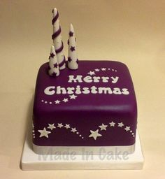 "A 5"" square fruit cake made to match the Christmas decorations."
