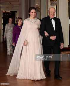 Britain's Catherine Duchess of Cambridge walks with Norway's King Harald on their way to the official dinner at the Royal Palace in Oslo on February...
