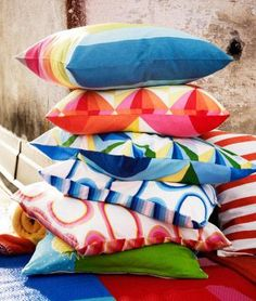 A pile of cushions in bright colours