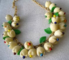 Vintage celluloid flowers and leaves  unsigned Miriam Haskell necklace.. $175.00, via Etsy.