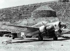 A Savoia-Marchetti SM.79 Sparviero of the 278th Torpedo Squadron of the Regia Aeronautica, parked outside one of the fortified hangars on Marghana Airfield, c.1941.
