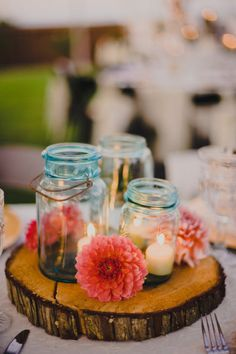 Mason jars are so versatile and can fit any wedding theme. Try out one of these mason jar wedding decoration ideas for your wedding reception. Wedding Centerpieces Mason Jars, Wedding Decorations, Table Decorations, Centerpiece Ideas, Wooden Centerpieces, Simple Centerpieces, Wood Slab Centerpiece, Candlestick Centerpiece, Wedding Centrepieces