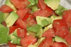 Avocado Tomato Salad is a great addition to any party especially in the winter. It brightens up the table and is full of healthy oil, vitamins, and minerals #paleo #GlutenFree
