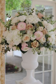 Floral Urn Arrangement created from white Hydrangea, Blush Ranunculus, Quicksand Roses, Bombastic Roses, scented garden Roses and Stocks, Astrantia. #romantic and #glamours. Designed and created by www.hannahberryflowers.co.uk for a wedding at Northbrook Park located in Surrey