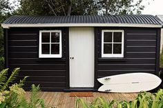 "Love the black exterior. ""The exterior is painted in Double Cod Grey by Resene Paints,"" Gemma says. ""The cabin was originally an old railway shelter used by railway workers in remote locations. Exterior Colors, Exterior Design, Interior And Exterior, Black Exterior, Exterior Siding, Surf Shack, Beach Shack, Apartment Therapy, White Cabin"