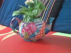 It's a flower, in a fabric covered teapot - of course!