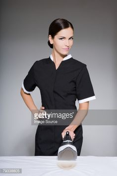 Stock Photo : Maid holding an iron