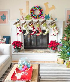 Whimsical Christmas Mantel - Love the JOY above the fireplace!
