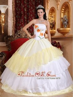 Romantic Light Yellow and White Quinceanera Dress Strapless Organza Embroidery Ball Gown  http://www.fashionos.com  If you want to find a gorgeous quinceanera dress,this is the best choice.It features a pretty strapless bodice with a straight neckline. The bodice is heavily embellished with special flowery embroidery. The full skirt creates a beautiful shape to complete the dress.