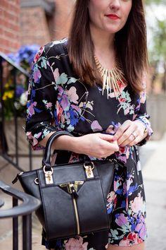 Floral romper + black leather handbag