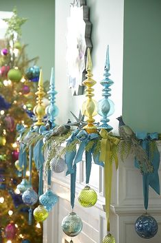 Try hanging ornaments from ribbon to your mantle this holiday season for a unique but beautiful display!