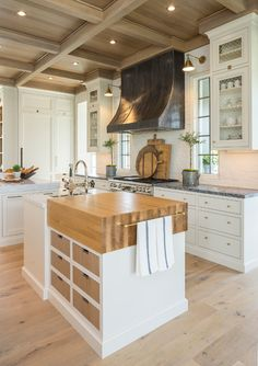 Kitchen Island. Kitchen Island with Butchers Block Countertop and vegetable…