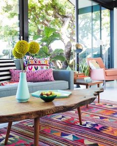 This bright happy space by Emily Henderson is full of personality love the kilim rug and use of global textiles