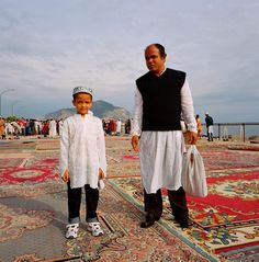 Alfredo D'Amato, Father and son during prayers by the coast to celebrate Eid ul-Fitr, marking the end of the holy month of Ramadan. Palermo, Sicily, Italy, 2008. © Alfredo D'Amato / Panos Pictures; panos.co.uk