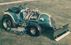 Power Mower -Fully equipped w/front blade to remove all obstacles for faster mow times, great idea!