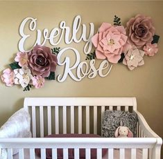 Blush pink and mauve nursery with wall flowers above crib #nurserydecor #nurseries