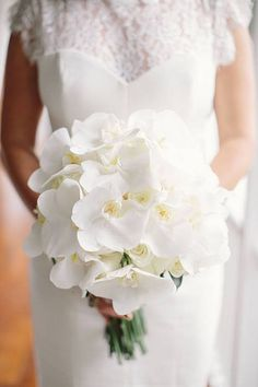 Caroline and Matthew, Destination Wedding at Round Hill Resort Jamaica - All-White Orchid Bouquet
