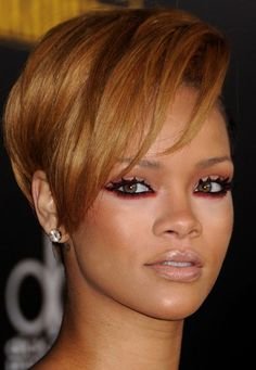 line the rims of the eyes with red eyeshadow after black eyeliner