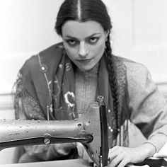"""#TBT to 1982. Witchy woman behind the sewing machine—braids, tons of dark eyes, red lips and nails—and hours at the sewing machine. #VintageKamali…"""