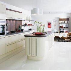 White cabinets, dark counters with white floors.