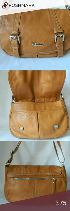 Genuine Italian Leather Valentina  Crossbody Can be worn as a shoulder bag or crossbody. Soft italian leather clean inside and out. Medium in size with 4 slip pockets and 2 zip pockets  Nice! Preowned clean inside. May show minor signs of wear as it is a preloved item! Durable natural color leather Valentina Bags Crossbody Bags