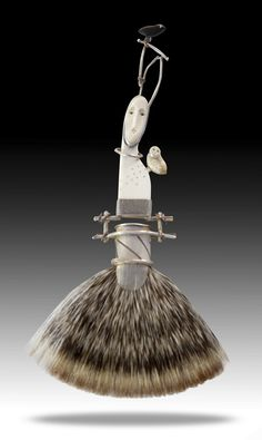 """Carolyn Morris Bach: Functional or Wearable Brush. This beautiful piece of jewelry is made from fine and sterling silver, copper, cow bone, fossilized ivory, and ebony. The brush is made from badger hair bristles. Size: 7"""" x 3.5"""" www.carolynmorrisbach.com"""