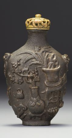 An 'iron-imitation' porcelain snuff bottle, Qing dynasty, 18th- 19th century