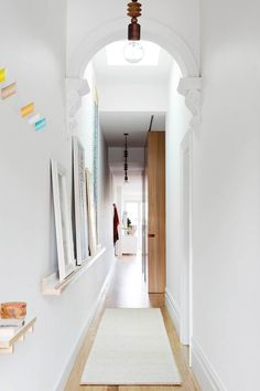 charming terrace homes have been redesigned and renovated to accommodate for modern day living while still retaining the classic period charm. Hallway Art, Hallway Lighting, Entry Hallway, White Hallway, Hallway Ideas, Entryway, Victorian Terrace Interior, Victorian Homes, Dulux Paint Colours White