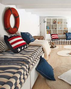 Nautical decor in a space with red, white and blue details