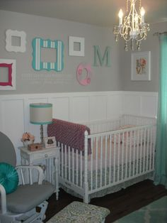 loving gray in babies room and adding bright pops of color with the frames.   #nursery #paintedframes