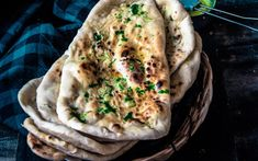 How do you get restaurant-style naan? This recipe shows you three ways to make naan — in the oven, on a skillet, or in a pressure cooker.