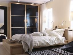 I have this IKEA Malm bed in oak color. I plan to order the Pax wardrobe, similar to this, with gray sliding doors because you can't get black anymore. They also don't make the little storage unit at the end of the bed in oak anymore.