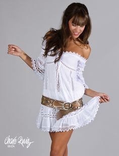 Beautiful off the shoulder boho chic frock belted at the hip with a studded tan leather belt. Charo Ruiz.