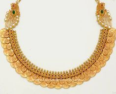 Lakshmi Kasulaperu in a layered design with peacock side motifs. The large lakshmi kasu and small lakshmi coins overlapped in a layered fashion Gold Jewellery Design, Gold Jewelry, Gold Necklace, Short Necklace, Temple Jewellery, Kerala Jewellery, Necklace Designs, Indian Jewelry, Wedding Jewelry