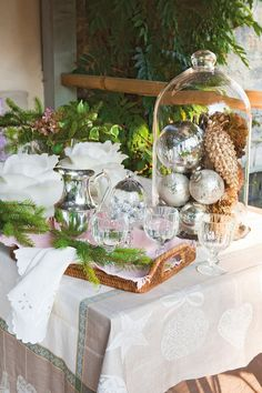 the tablecloth with beach designs is beautiful.  French Country Cottage with Christmas Decor