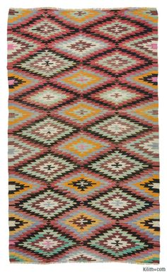 Vintage kilim rug hand-woven in Afyon, located inland from the Aegean coast of Turkey in 1960's. This lovely tribal kilim is in very good condition.