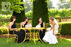 Bride and her bridesmaids enjoy a glass of bubbles on the lawn at Centennial Vineyard in the Southern Highlands of NSW | Photo Credit: Vibrant Photography