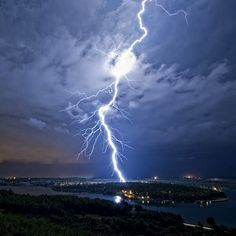 A bolt of lightning strikes the sea near Pula, Croatia. - photo by Matija Sculac / Barcroft Media; Pula, Weather Cloud, Wild Weather, Strange Weather, Extreme Weather, Tornados, Lighting Storm, Pictures Of Lightning, Thunderbolt And Lightning