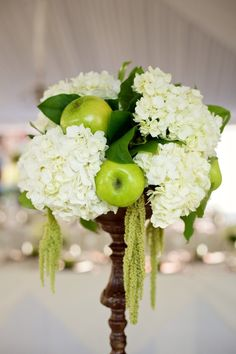very simple white and green centerpiece