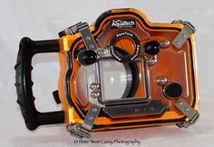 Aquatech CO-7 Underwater Sport Housing review - rated to 33', so meant for snorkeling, not scuba. $995 at B http://www.bhphotovideo.com/c/product/756064-REG/Aqua_Tech_1093_NY_7000_Sport_Housing_for.html, rental $ 290/week http://www.borrowlenses.com/product/underwater_nikon/aquatech_ny7000