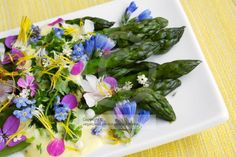 Green asparagus with a saffron sauce and edible flowers.