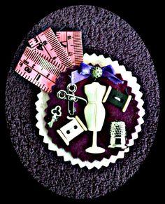 Broche costura maniquí