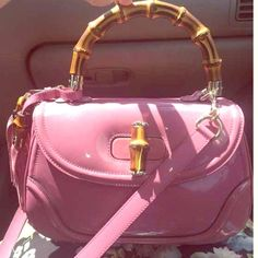 RARE Gucci bamboo top handle bag Seriously just bought this for myself but I'm craving a different style of bag. Gorgeous mauve pink patent leather in PRISTINE condition. I've used it 3 times, real bamboo turn lock and top handle. Sold out everywhere very rare. Looking to sell and ONLY looking to trade for like new LV (not vintage) or a Chanel le boy or a Chanel flap bag in amazing condition. Trade value: 3000 Gucci Bags