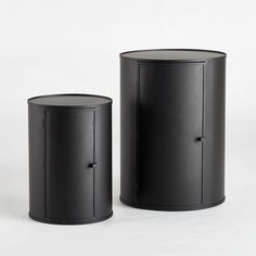 Vesper side table. This rounded and reversible unit can be used as a side table. Available in 2 sizes.Features:In metal with an epoxy finish. 1 door. 1 fixed shelf.Door opens to the left and the right. Size:Size S: Ø30 x H43cmSize M: Ø40 x H55cm