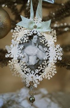 victorian style christmas ornament . via artful affirmations . using two different snow flake punches, vintage beads, and image of Jane Austen .  ornament back has a copy of a letter Jane wrote to her brother