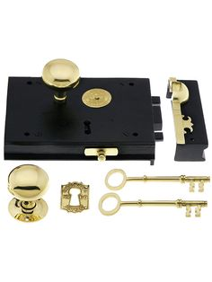 Cast Iron Carpenter Rim Lock Set With Brass Door Knobs and Escutcheons - just the right thing for the front door of a Federal or Greek  Revival style home.
