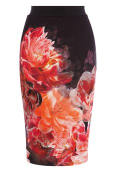 A gorgeous bandage scuba skirt crafted from neoprene that hugs your curves for a sensational silhouette. The Peony Bloom Pencil Skirt fits high on the waist with an elasticated band that cinches you in beautifully. This skirt features a fresh contemporary floral print, team with the Fray top for a modern look this season. Skirt measures 25.5 inches/65cm from waist to hem.